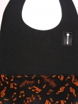 Black Textured BossBib with Orange Musical Notes on Black Lining